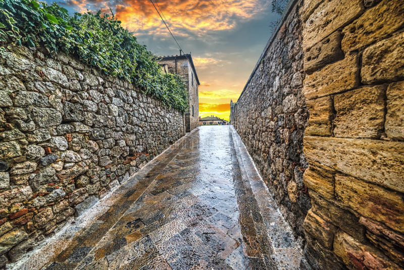Narrow alley in Monteriggioni. Italy stock photography