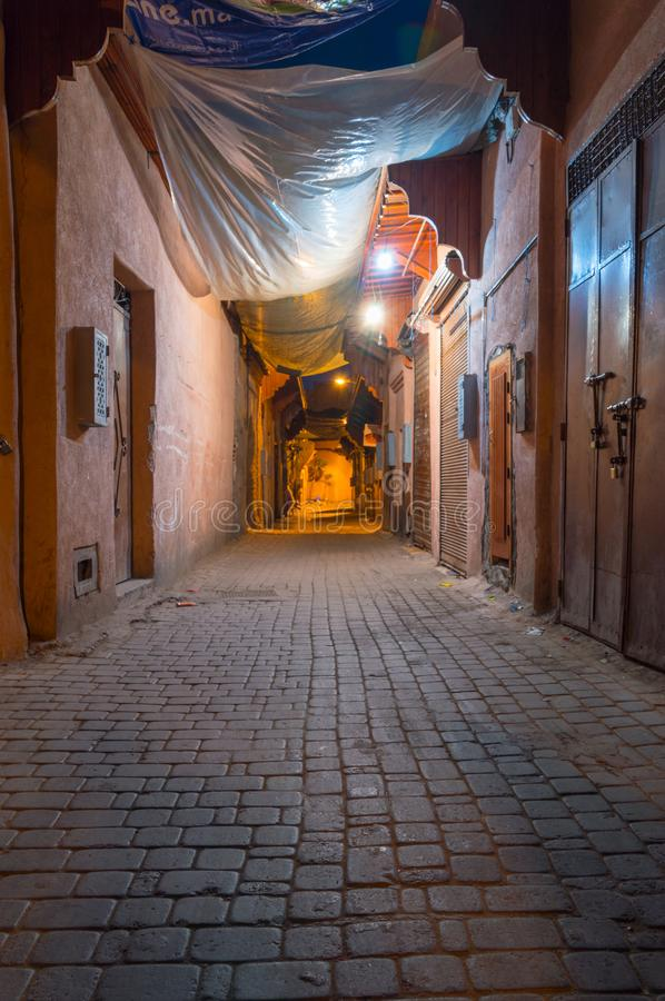 Small alley at night in Marrakech, Morocco royalty free stock image