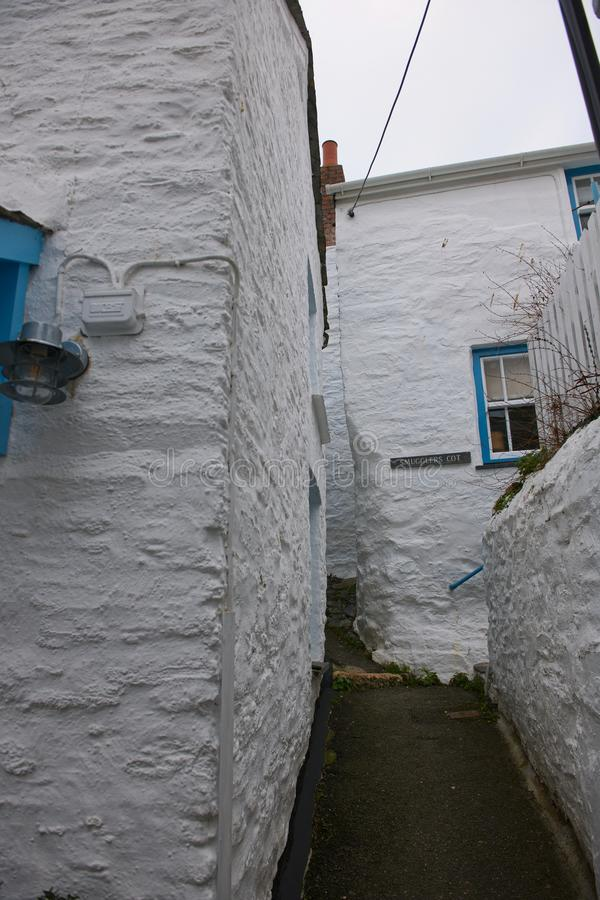 Narrow alley in Port Isaac. Narrow streets wend there way past cottages in Port Isaac. Port Isaac is a traditional fishing village in Cornwall. It is the setting royalty free stock photo