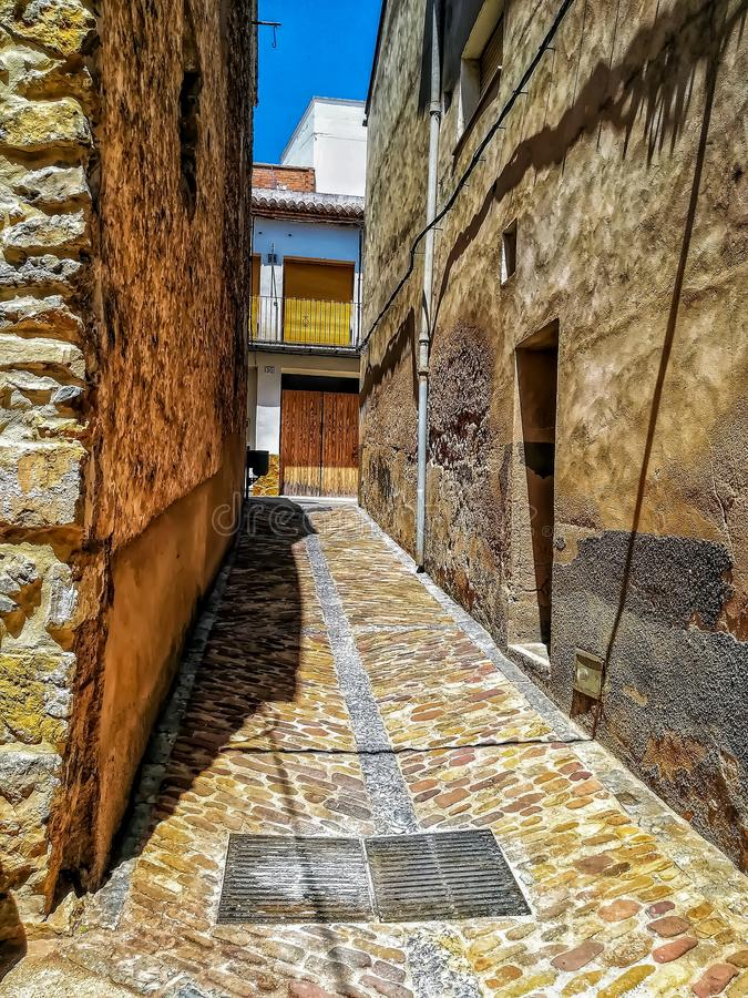 Narrow alley with stone floor stock photos