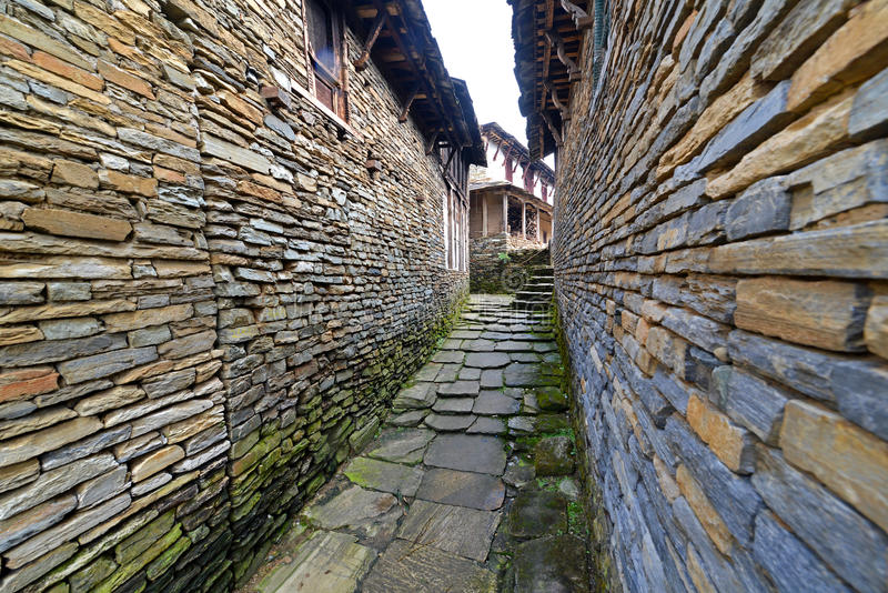 Narrow alley between stone houses. In Ghandruk village. Himalaya mountains, Nepal stock photos