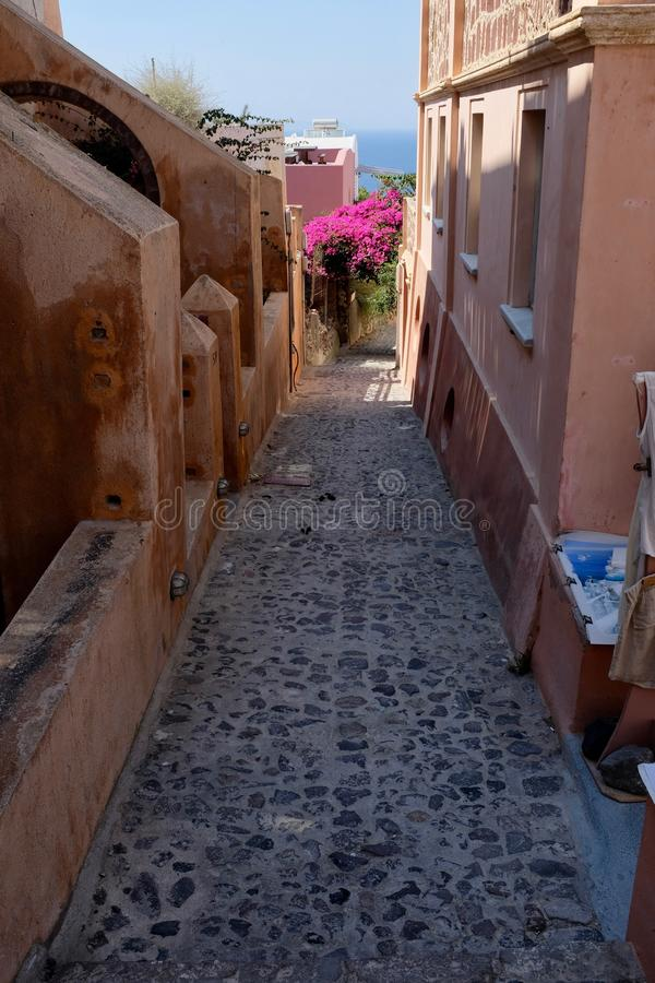 Narrow Alley in Oia Village stock photography
