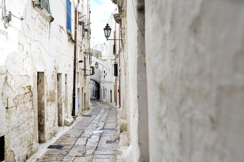 Narrow alleyway in Ostuni, Apulia, Italy stock photos