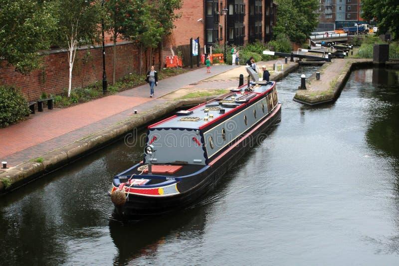 Narrow boat leaving lock, Birmingham city center royalty free stock images