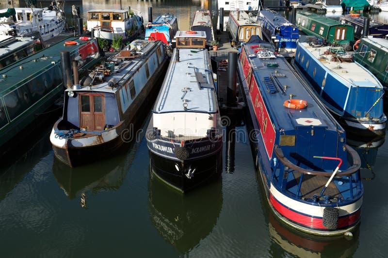 Narrow boats moored in Limehouse Basin, London, UK. June 9 2012, London, UK: Narrow boats moored in Limehouse Basin, an inner city marina or dock, London, UK royalty free stock photo