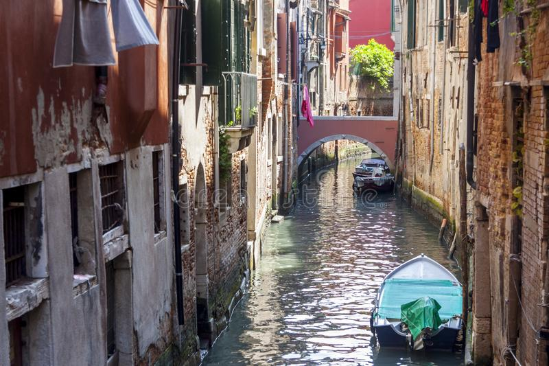Narrow canal in old town of Venice - Italy royalty free stock photo