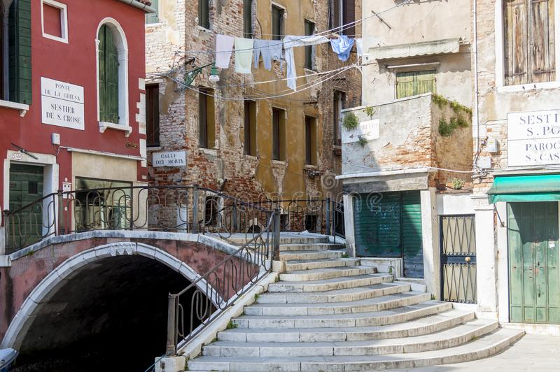 Narrow canal in old town of Venice - Italy stock photography