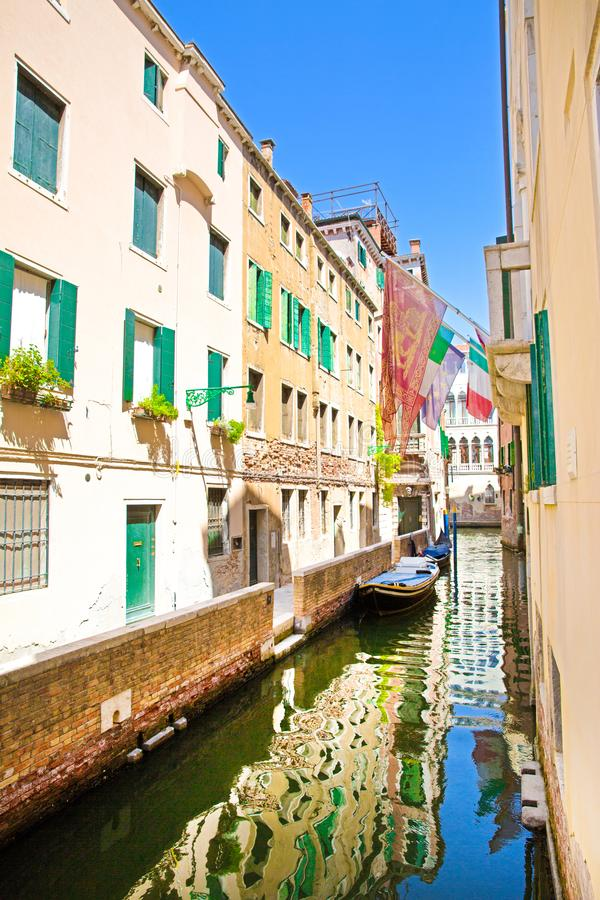 Narrow canal in Venice, Italy. Old buildings reflect in green canal water. Amazing view to the narrow canal in Venice, Italy. Old buildings reflect in green royalty free stock photography