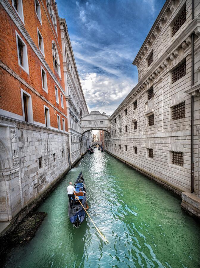 Free Narrow Canal With Gondola In Venice, Italy. Architecture And Landmark Of Venice. Cozy Cityscape. Place To Travel Royalty Free Stock Image - 215028716