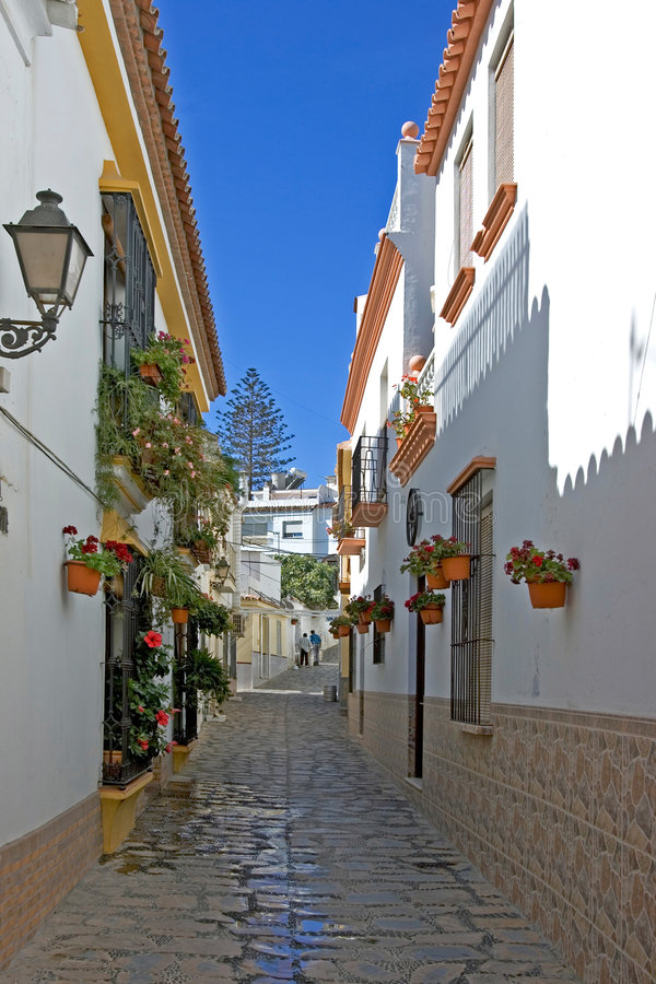 Narrow cobbled colourful back street in Estepona Spain stock photography