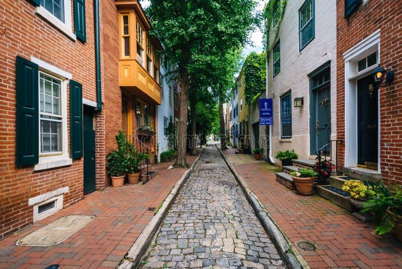 A narrow cobblestone street near Filter Square, in Philadelphia, Pennsylvania stock image