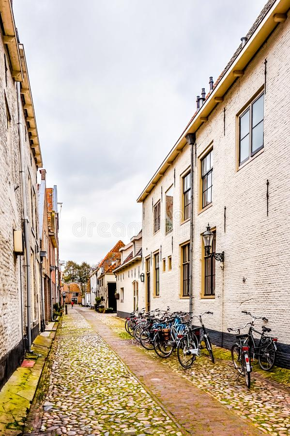 Narrow cobblestone streets in the village of Elburg in the heart of Holland stock images