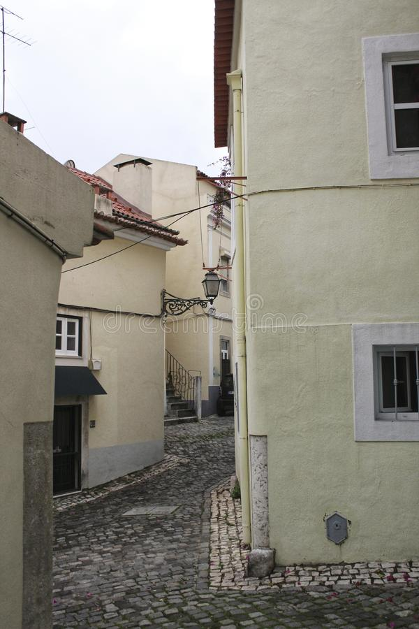Narrow and colorful streets of Lisbon stock photo