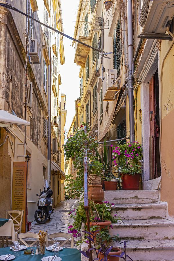 The narrow colorful and tourist streets or Corfu Town, Corfu, Greece.  stock photo