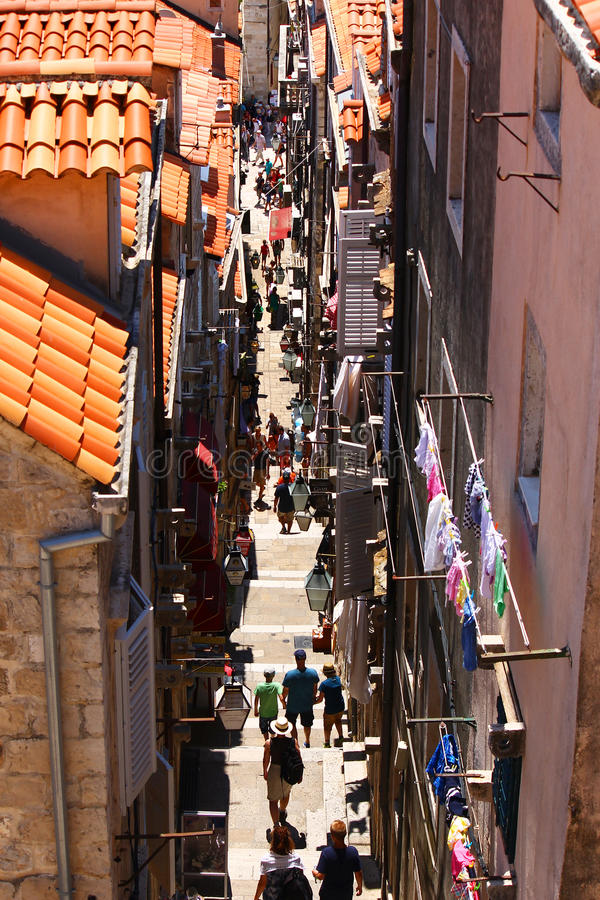 Narrow descending alley with people royalty free stock photos