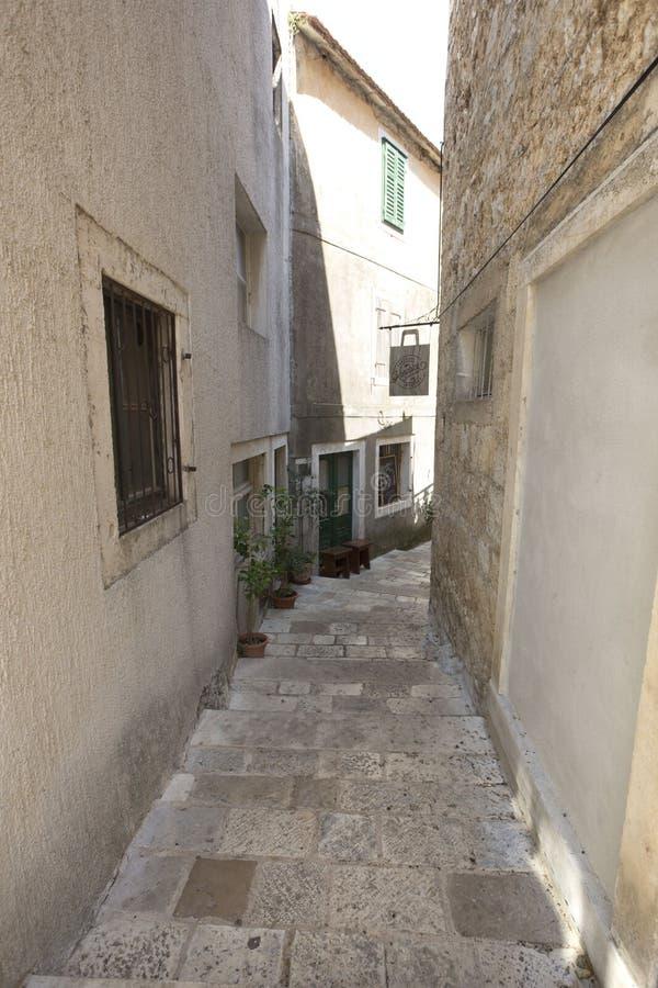 Narrow empty street of medieval town in croatia stock photo