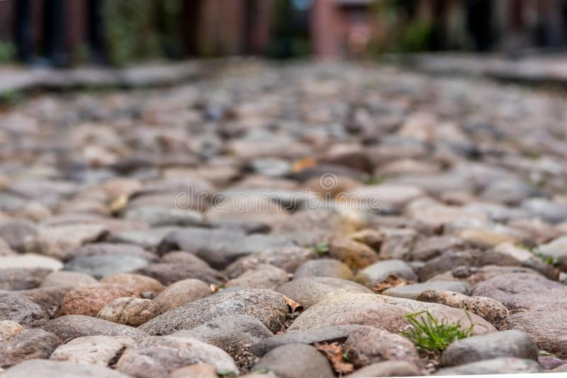 Narrow Focus of Cobble Stone Street royalty free stock photo