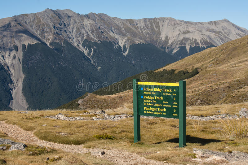 Narrow footpath with board in Nelson Lakes royalty free stock photography