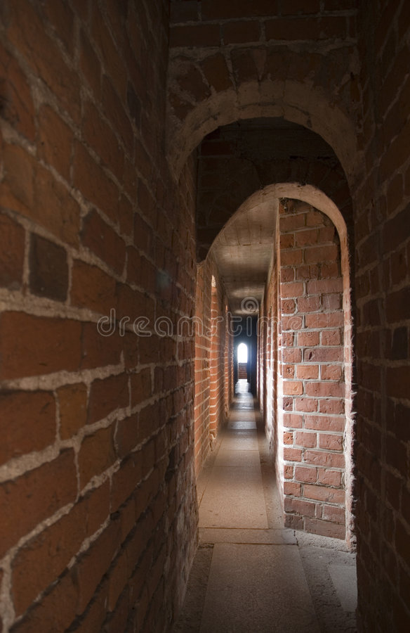 Narrow gallery with arches. Narrow oblong gallery with arches in the Malbork castle, Poland royalty free stock photo