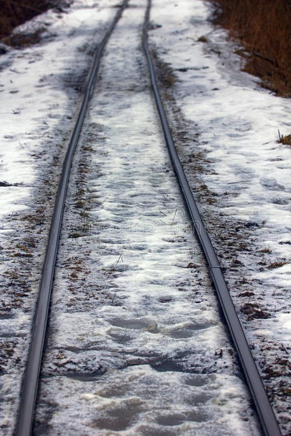 Railroad in snow. Narrow gauge railroad (dolly way) in logging. Remains of camps for political prisoners, Stalins camps royalty free stock images