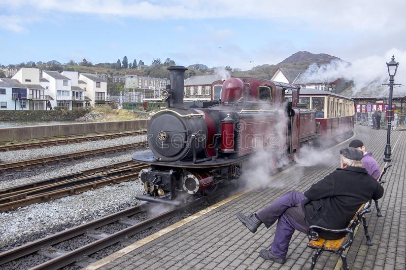 Narrow gauge steam locomotive in the station at porthmadog. Double headed steam engine on the ffestiniog railway at porthmadog wales royalty free stock image