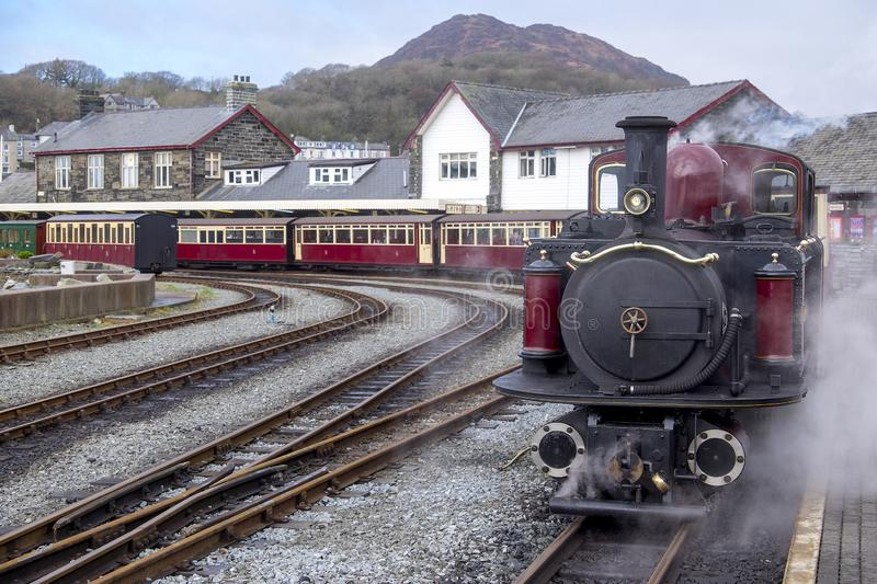 Narrow gauge steam locomotive in the station at porthmadog. Double headed steam engine on the ffestiniog railway at porthmadog wales royalty free stock photo