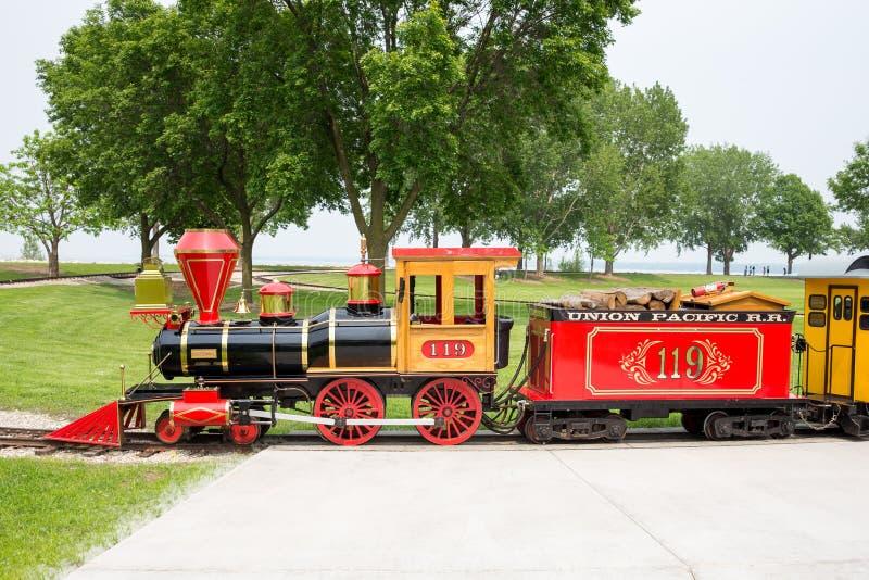 Narrow Gauge Train at Bay Beach Amusement Park. GREEN BAY WI - June 9, 2015: Narrow gauge train engine at Bay Beach Amusement Park, a popular tourist attraction stock image