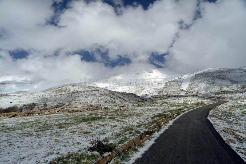 The road to Syria on the slopes of Qurnat as Sawda - Lebanon`s highest peak. royalty free stock image