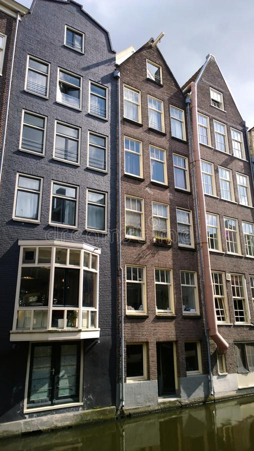 Download Narrow High Beautiful Houses In The Centre Of Amsterdam On The  Water. Vertical View