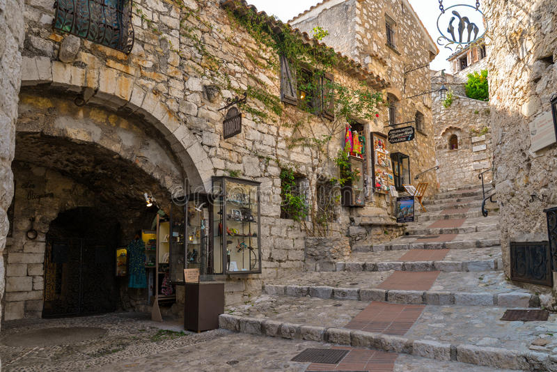 The narrow hilly street in Eze stock photos