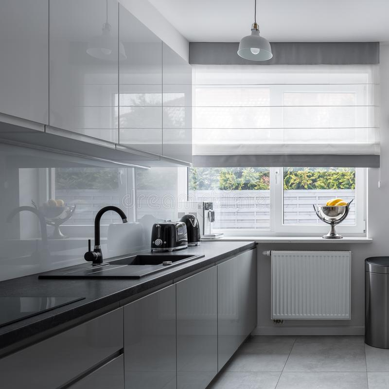 Narrow kitchen with contemporary furniture stock image