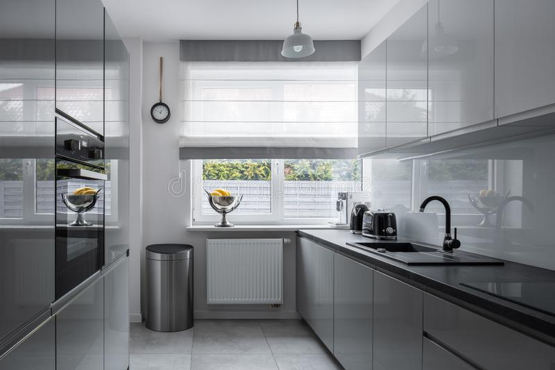 Narrow kitchen with modern furniture royalty free stock photography