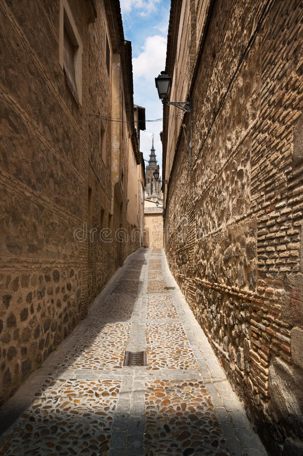 Narrow lane in old town of Toledo, Spain royalty free stock image
