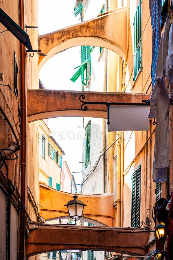 Narrow medieval Old Town street full of construction arcs hanging between the buildings facades. Narrow ancient medieval Old Town street full of construction stock photos