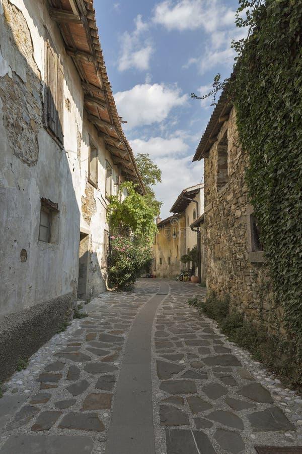 Narrow medieval street in Smartno village, Slovenia. Narrow medieval street in Smartno village, Brda region in Western Slovenia royalty free stock images