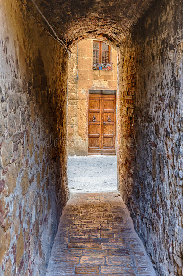 Narrow old alley. Into a street with a door stock photo