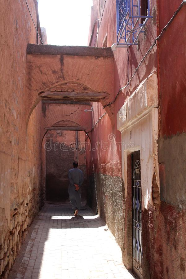 Narrow old street in medina - historical centre of Marrakesh stock images