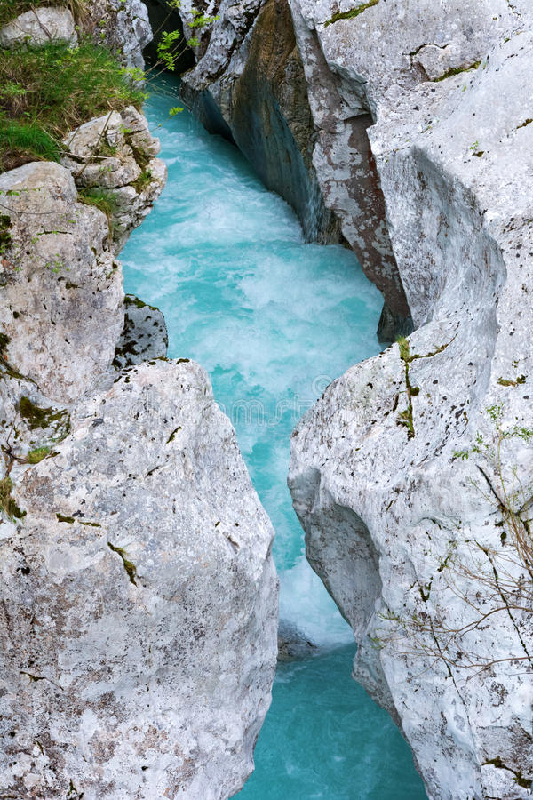 Narrow part of Soca river where you are able to jump over stock photography