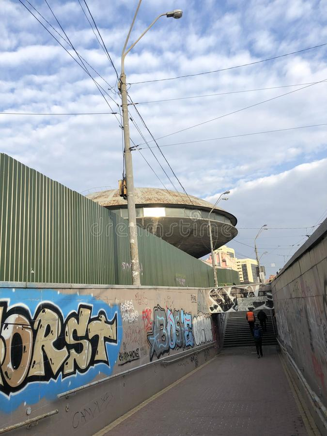 A narrow passage between the fences, a modern underpass with a tunnel with informal graffiti. Georgia, Batumi, April 18, 2019 royalty free stock image