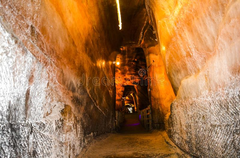 Narrow path & cave inside Khewra salt mine. The Khewra Salt Mine is located in Khewra, north of Pind Dadan Khan. In 326 BC, Alexander the Great, the Greek royalty free stock images