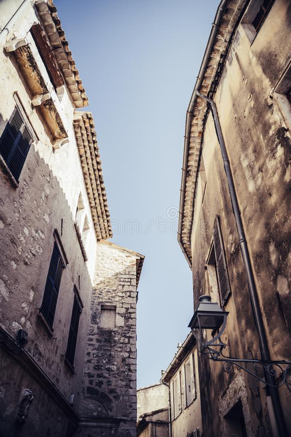 Narrow pedestrian alley between old houses in an old town in Europe royalty free stock image