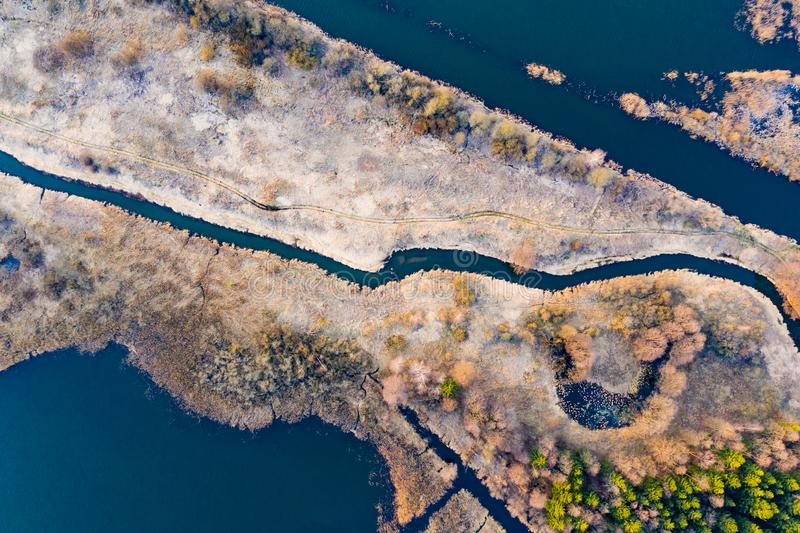 Narrow river separating dry land in autumn, aerial scenery. Environment concept. Narrow river separating dry land in the autumn, aerial scenery. Environment royalty free stock images