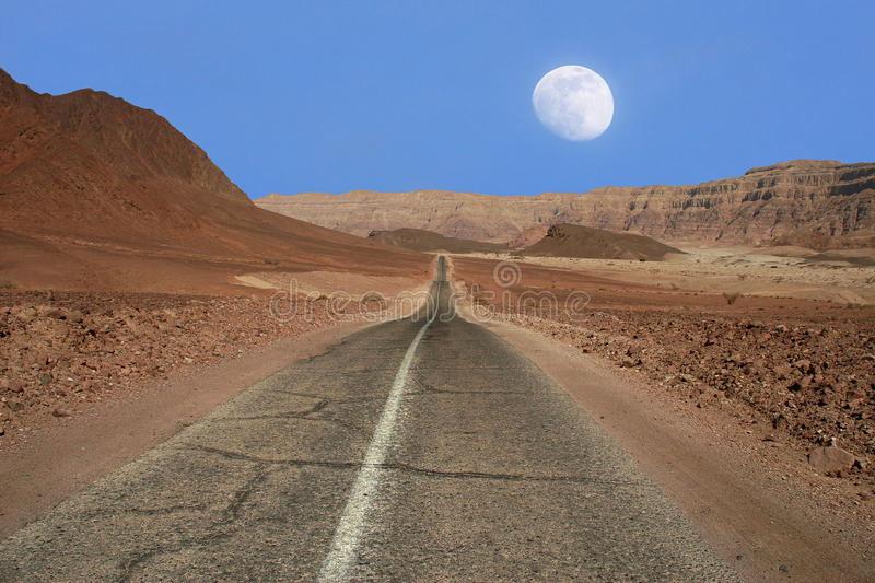 Narrow road through the desert in Israel. stock photos