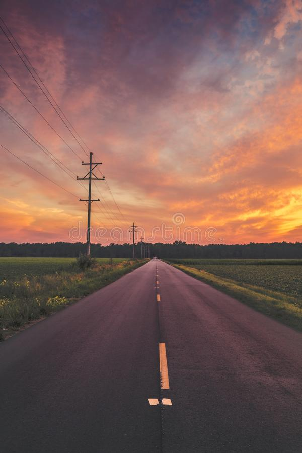 Narrow Road during Sunset royalty free stock image