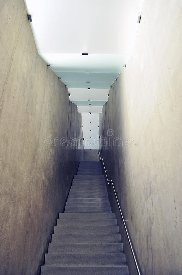 Concrete staircase. Light narrow concrete staircase royalty free stock photo