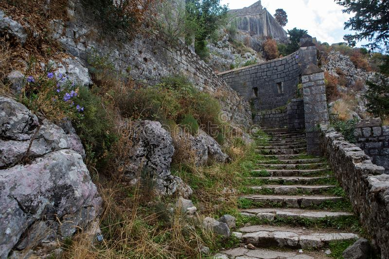Narrow stone road to the fortress wall royalty free stock images