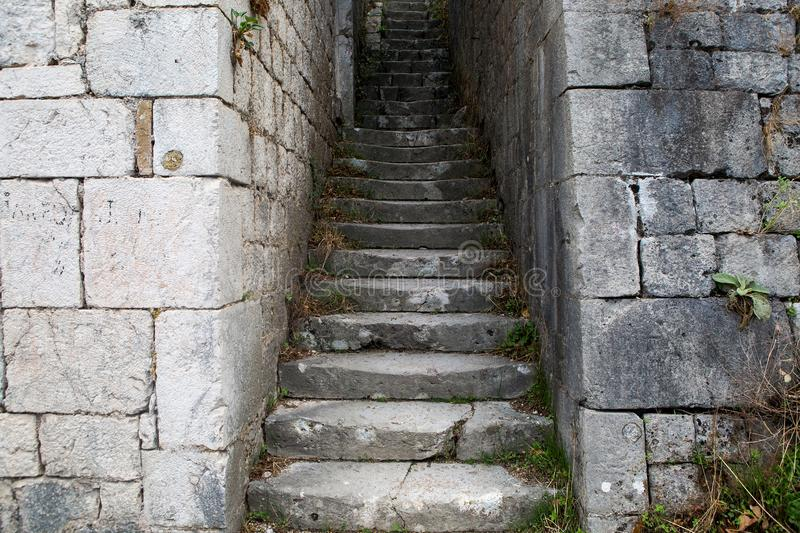 Narrow stone road to the fortress wall royalty free stock image