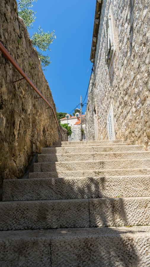 Narrow stone stairs between old residential area in croatia. Adriatic coast village with stone houses and Old stone street of. Cavtat, town in south Dalmatia royalty free stock image