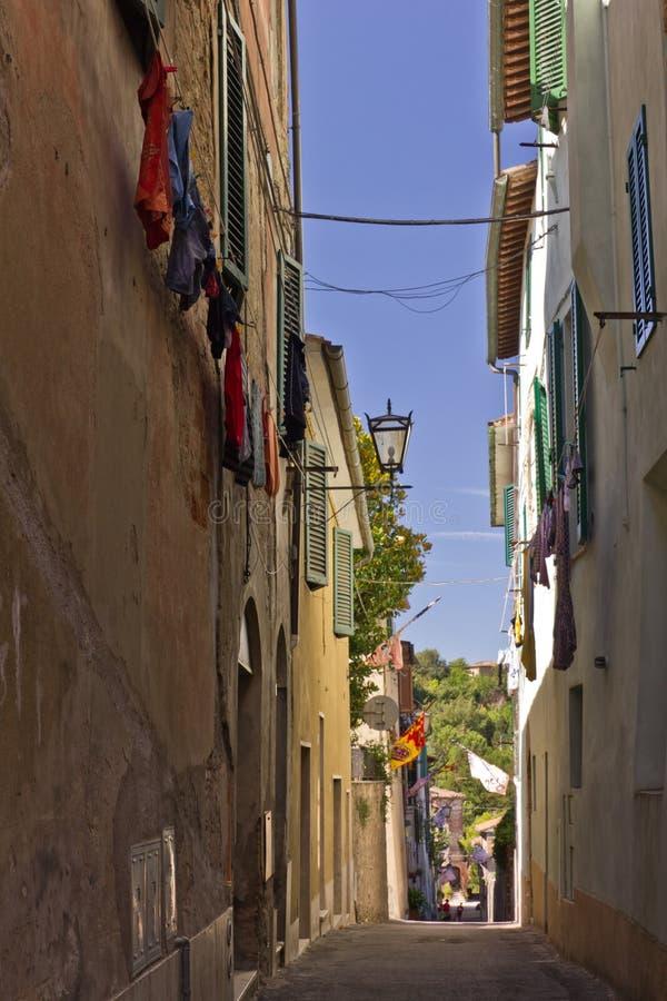 Narrow street in Asciano, Italy royalty free stock photos