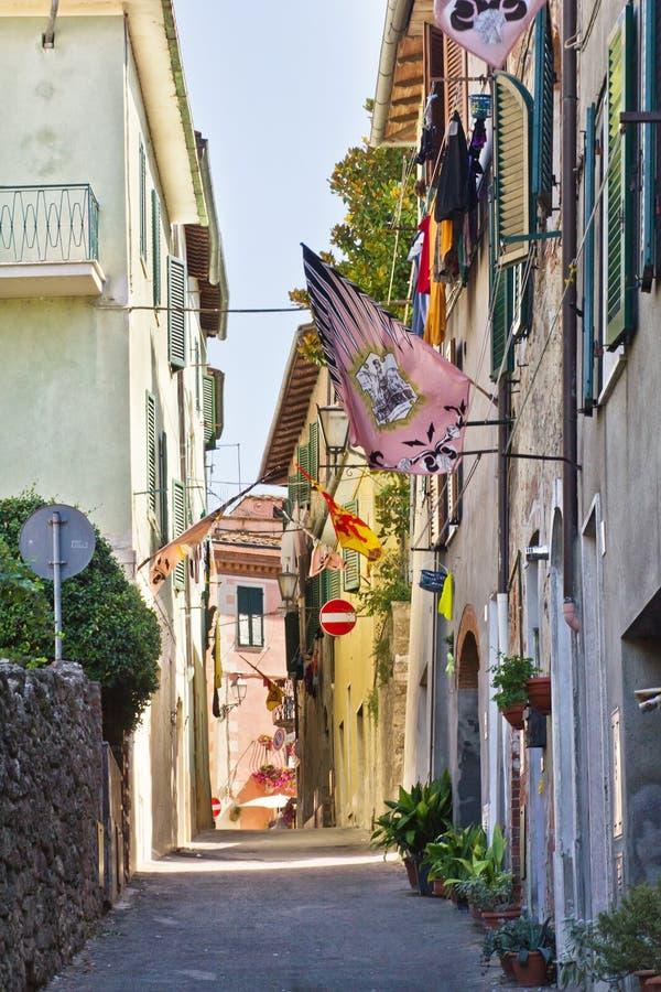 Narrow street of Asciano, Italy royalty free stock images